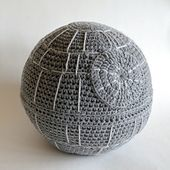 If you love Star Wars you might want to have this sofa cushion in your home! Made with worsted weight acrylic yarn, this sphere is approx 24-27 inches circumference.