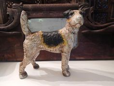 This is a great vintage style dog bank or doorstop. It's made from cast iron and has a great feel to it. Its hand painted and has a great patina, giving it that great vintage charm.