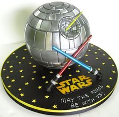 This great Star Wars Death Star Cake looks at home on its star covered cake board.