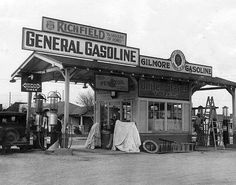 Richfield Gasoline, Gilmore Gasoline, and other signs adorn a service station at Long Beach Boulevard in South Gate, California. It was owned and operated by Louie Meyers and his wife, June (June Via the Herald-Examiner collection Old Gas Pumps, Vintage Gas Pumps, Pictures Of Gases, Pompe A Essence, Gas Service, Automobile, Old Gas Stations, Old Country Stores, Filling Station