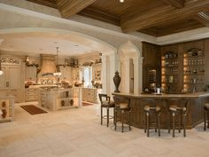 "French Colonial Kitchen and bar area next door. Tapered French limestone floor gives kitchen some ""ooo-la-la"" oomph."