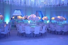 We worked with Linda Howard Events and LA Premier Flowers to create this incredible reception design for a wedding at the Beverly Hills Hotel. We hung thousands of crystals on silk ribbons in the ballroom. The space was transformed by lighting, changing from blue to pink throughout the evening.