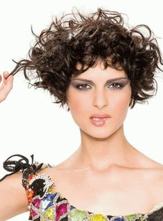 Cute short curly haircut. Okay, it\'s more wavy than curly ...