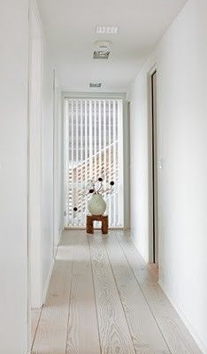 white stain on wood floors.  Thinking about doing this on the wood floors up stairs in my hall and on the stairs to brighten things up.