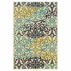 Woven indoor/outdoor rug with a scrolling floral motif.  Product: RugConstruction Material: PolypropyleneColor: Ivory and multiFeatures:  Machine-wovenSuitable for indoor and outdoor use Note: Please be aware that actual colors may vary from those shown on your screen. Accent rugs may also not show the entire pattern that the corresponding area rugs have.