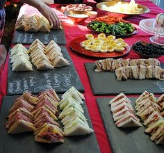 No recipes just a serving idea. Curried Chicken & Apple, English Cheddar & Spring Onion, Turkey & Cranberry, BLT, Pastrami & Swiss, PB&J, Cream Cheese & Cucumber, Egg Salad, Smoked Salmon & Dill and at least two others. All laid out on slate boards with chalk descriptions for the guests.
