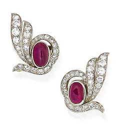 A pair of ruby and diamond earclips, by Lacloche Frères, circa 1930  Each cabochon ruby within a scrolling surround of single and brilliant-cut diamonds, diamonds approximately 1.50 carats total, signed Lacloche Frères London