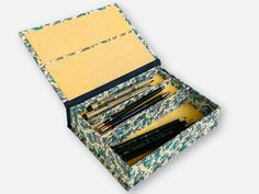 "Box with divider and half-width tray. Covered in Rossi Italian decorative paper (""carta fiorentina""), with the cover inset and bottom lining in Favini ""gold"" parchment paper."