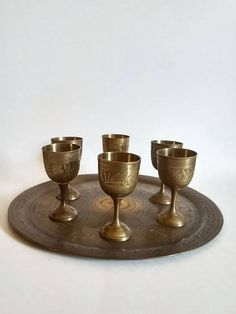Carved Brass Platter with 6 Mini Goblets by SamsOldiesButGoodies on Etsy
