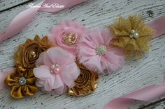 This is beautiful gold and Pink Flowers Sash Belt, the sash make from light pink satin ribbon trim. The sash make from satin Ribbon pink color, 1 inch wide and 3 yards long. The flowers on sash is about 9 inches long.   Great for dress, flower girls dress, maternity photo shoot Make from shabby flowers, satin flowers with rhinestone on central    from non smoking environment and free pet  Wash hand and lay flat to dry Any question please convo or e- mail me a message   Thank you