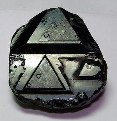 trigons on a very deep green crystal of Tourmaline.