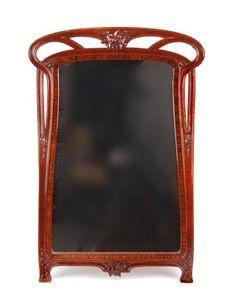 Eugéne Gaillard (1862-1933) - Mirror. Carved Mahogany, Rosewood Veneer and Mirrored Glass. Nancy, France. Circa 1900. 84.5cm x 57.5cm.