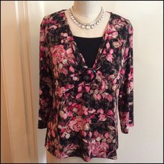 Roses Are Red Top This top has a pretty pattern of roses and leaves. Great shades of reds and pinks. Black background with touches of tan. The front has a great neckline accented in the bottom part of the v neck with a black ring which has material weave thru it. The bust line is accented with a band that runs under and  gives the front a nice drape the sleeves are 3/4 in length. Very cute top for your favorite jeans. 95% Polyester 5% Spandex Machine wash /dry low ✨Bundle And Save✨ JM…