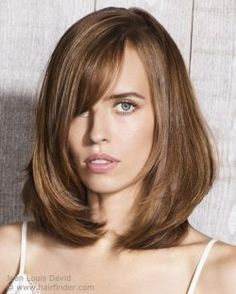Almost shoulder length bob with layers.  Brown hair.