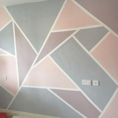 Painted wall in Everlong Paint Earl grey and Sophia to create geometric shapes