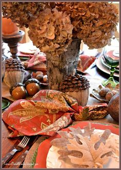 It is the large acorns made of burlap and pine cone petals that interest me, might be worth trying to reproduce diy.  Corner of Plaid and Paisley: Fall Leaves and Acorns Tablescape