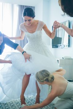 Photo idea - Mother of the Bride and Maid of Honor dressing the bride