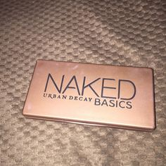 Naked Basics Palette Has been used a bit, still a lot of eyeshadow left. Does not come with the box. Urban Decay Makeup Eyeshadow