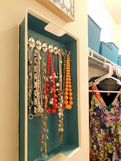 A metal tray and some hook magnets = AWESOME necklace organizer :)