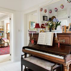 Characterful hallway with piano | Hallway decorating idea | Style at Home | Housetohome.co.uk