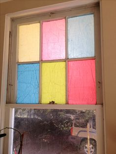 Decoupage tissue paper on windows for a stained glass effect!   1. Make your own decoupage using 1/2 Elmer's glue and 1/2 water.   2. Using a foam brush, apply a coat of glue to clean window.  3. Apply tissue paper cut to size.  4. Apply another coat of decoupage.  Get creative! You can experiment with layering colors, or anything else you can think of!   To remove, simply wet the tissue thoroughly and scrape off with plastic scraper.