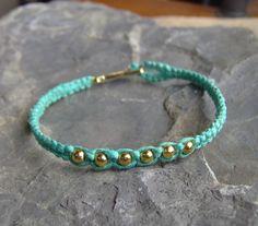 Hemp Bracelet - Turquoise Blue Hemp w/ Gold Color Beads - Hemp Jewelry. $7.00, via Etsy.