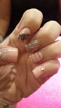 Gold pink and feather nails!