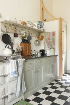 Love the floor with grey cabinets. Needs wooden bench top. Don't go for shelf.