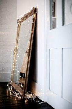 Fairy lights around mirror
