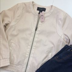 "3X HPAnn Taylor Vegan Leather Jacket Pictures don't do this justice! This beautiful Ann Taylor jacket works for every season. Dress it up or down. Darling with jeans & booties. Very pretty cream color that I can't capture with my phone camera. Front pockets and elastic bottom and sleeves. Zip closure. Fully lined. See pictures for fabric and care. Measurements: chest armpit to armpit 20""; Bottom, lying flat, unstretched 17""; length shoulder to hem 21""; sleeve 23"".❤️ Jeans & booties are…"