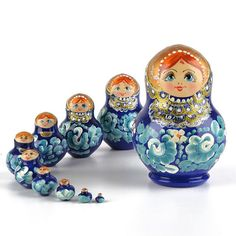 """10 pc #Matryoshka in #Blue - $56.99 Beautiful blue color with gold sparkle accents were painted on this """"short and chubby"""" matryoshka nesting doll from #Russia, which is Approximately 5 1/4"""" tall. She would be a lovely addition to any room with a blue color scheme, or a unique conversation piece to any color room! Hand-made item; your doll may vary slightly from the one pictured here."""