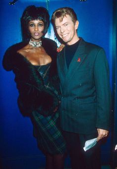 Mandatory Credit: Photo by Richard Young/REX/Shutterstock (223095a) Iman and David Bowie AIDS Benefit Concert, London, Britain - 1993