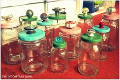 DIY: reuse glass jars - remove stickers with goo gone, spray paint lids, punch hole in lid and add drawer knob. Love!