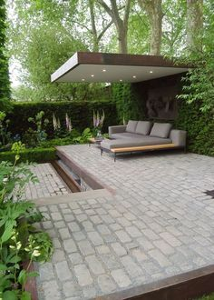 chelsea flower show 2016 Support the husqvarna garden. This modern landscaped backyard has a raised outdoor lounge deck, a wood burning firepit, succulents, bamboo and a vegetable garden. Contemporary Garden Design, Modern Landscape Design, Modern Landscaping, Landscaping Ideas, Contemporary Building, Contemporary Interior, Landscaping Software, Rustic Contemporary, Bamboo Landscape