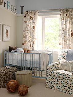 Blue crib and chair rail that is high. Love that idea!