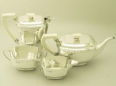 A fine and impressive vintage George VI English sterling silver and ivory handled four piece tea and coffee service in the Art Deco style; an addition to our teaware collection  SKU: W8454 Price    GBP £2,850.00 http://www.acsilver.co.uk/shop/pc/Sterling-Silver-Four-Piece-Tea-and-Coffee-Service-Art-Deco-Style-Vintage-George-VI-p6082.htm