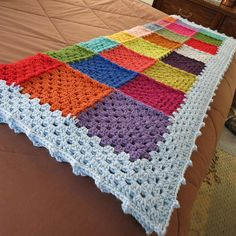 Granny square afghan. I don't think I would do white around the edges...maybe brown or tan.