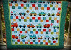 Fun Trucks and Cars Quilt | Pink Polka Dot Creations. The  vehicles are all printed in a panel. Would be oh, so quick.