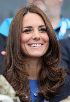 Kate Middleton attended the Commonwealth Games with her trademark face-framing layers and a wash of rosy blush.