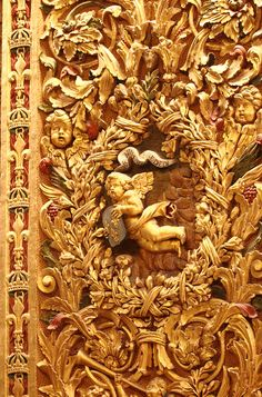 baroque details in a gold wall