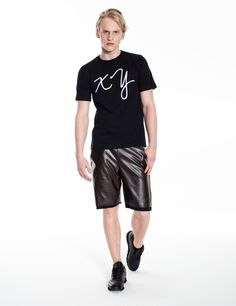 Model is wearing: XY chromosomes t-shirt in black & brown COMBO shorts made of eco-leather and cotton