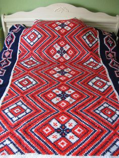 vintage crochet afghan blanket. red, white and blue ikat. twin.. $37.00, via Etsy.