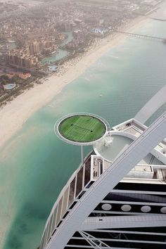 Who's up for playing tennis 1000 feet in the air? You can at the Burj Al Arab hotel in Dubai which is the home of world's highest tennis court. The Burj Al Arab is also the worlds only 7 star hotel - efff this. Places Around The World, Oh The Places You'll Go, Places To Travel, Places To Visit, Around The Worlds, Burj Al Arab, Dubai Hotel, Dubai Uae, Dubai Trip