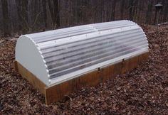 Raised Bed Hoop house made of plywood and corrugated polycarbonate plastic Tasty greens in the middle of winter!