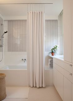 MODERN SHOWER CURTAIN - Floor to ceiling shower curtain using a ceiling track. Don't want to drill into the new tub/shower tile and hate tension rods, so this is the perfect solution. I can hide the track if needed with wood trim to match the new framed mirror above the vanity.