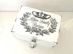 Welcome to Piccadilly Cottage!  This listing is for a beautiful White Wood Recipe Box-Hand Painted, Weathered and Distressed. It features a beautiful French Graphic Decal Wreath with Crown which perfectly frames your Name or Monogram! Anyone will love this personalized gift! It can be used as a Recipe Box- Storage Box, File Box or Memory Box. This Recipe Card Holder makes the perfect Housewarming Gift, Birthday Gift, Christmas Gift or Wedding Gift! Shown is our Large Recipe Box in…