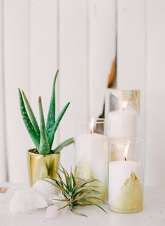 gold painted glass vases, photo by Blush Wedding Photography http://ruffledblog.com/modern-tropical-wedding-inspiration #weddingideas #decor