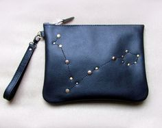 This beautiful leather clutch bag is made of soft black leather with zodiac constellation pattern on the front, made from different metal rivets