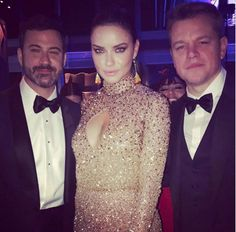 """Adriana Lima poked fun at Jimmy Kimmel's pretend feud with actor Matt Damon by posing between the pair at the Vanity Fair Oscars bash. """"Peacemaker Angel... Can't we all just get along? ?? @jimmykimmel #mattdamon #oscars #vanityfair"""" the Victoria's Secret model captioned the snap on Feb. 26, 2017."""