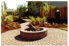 Design by Dave Kelly installed by Everything Outdoors Landscape & Construction LLC. Fire pit with paver walkway and waterfeature.   www.eolcllc.com